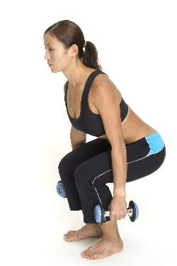 woman-doing-dumbbell-squats-middle-position