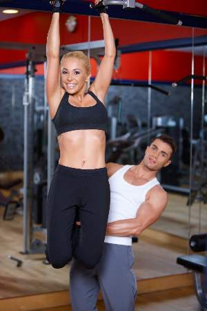 woman-doing-pull-ups-with-a-partner