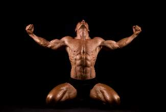 bodybuilder-flexing-and-kneeling-looking-up