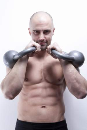 bodybuilder-standing-holding-kettle-bell-weights