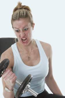 intense-women-looking-at-dumbbell