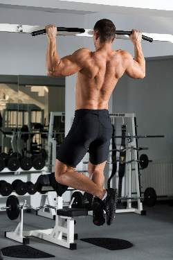 man-doing-pulls-ups-middle-position
