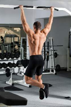 man-doing-pulls-ups-starting-position